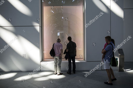 Visitors look at one of the exhibits in the Louvre Abu Dhabi museum during its official public opening, in Abu Dhabi, UAE, 11 November 2017. The dome was designed by French architect Jean Nouvel.