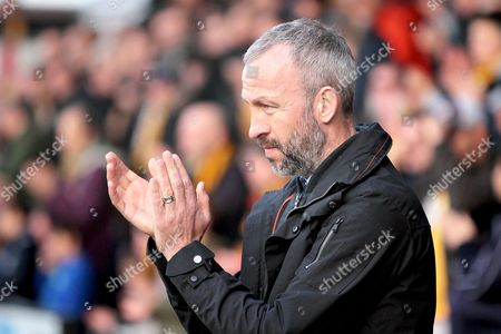 Cambridge Utd's manager Shaun Derry claps the fans after the minutes silence before the Sky Bet League 2 match between Cambridge United and Accrington Stanley at the Cambs Glass Stadium, Cambridge