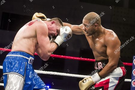 An image issued on 11 November 2017 shows Imre Szello of Hungary (L) and Robert Hall Jr of the US fighting during the World Boxing Federation (WBO) Intercontinental cruiserweight title bout at the Felix Promotion Gala in Salgotarjan 110 kms northeast of Budapest, Hungary, 10 November 2017. The undefeated 34-year-old Szello won with a knockout in the ninth round, and defended his title.