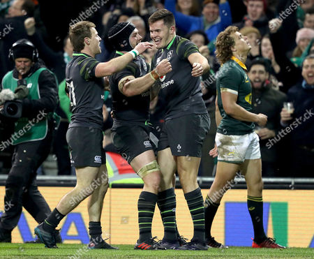 Ireland vs South Africa. Ireland?s Jacob Stockdale celebrates scoring his sides fourth try with Sean O?Brien and Kieran Marmion