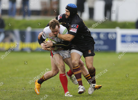 Stock Photo of Jack Arnott of Plymouth Albion is tackled by James Pritchard of Ampthill during the National Division 1 match between Plymouth Albion v Ampthill at the Brickfields Recreation Ground, on November 11th 2017, Plymouth, Devon, UK.