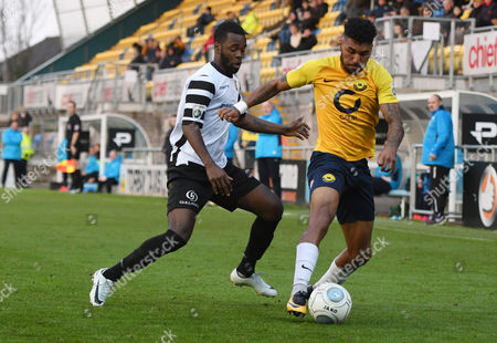 Jamie Reid of Torquay United battles for the ball with Zavon Hines of Maidstone United, during the Vanarama National League match between Torquay United and Maidstone United at Plainmoor, Torquay, Devon on November 11