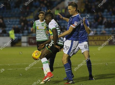 Yeovil player Jordan Green shields the ball from Carlisle United player Clint Hill during the Skybet League Two Match between Carlisle United and Yeovil Town at Burnden Park, Carlisle on Nov 11th