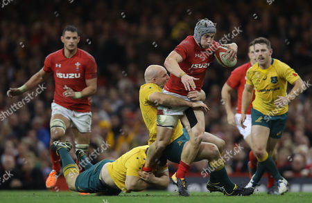 Jonathan Davies of Wales is tackled by Stephen Moore of Australia
