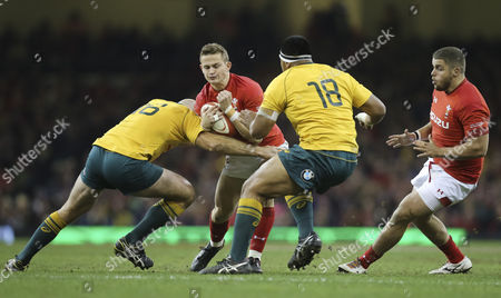 Stock Image of Hallam Amos of Wales takes on Stephen Moore of Australia and Allan Alaalatoa of Australia