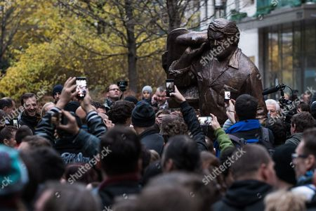 People attend the unveiling ceremony of the bronze statue depicting late Italian actor Carlo Pedersoli, professionally known as Bud Spencer on Corvin Promenade in Budapest, Hungary, 11 November 2017.  Former porfessional swimmer and water polo player Pedersoli, who starred in over twenty films with long-time on-screen partner Terence Hill, died on 27 June 2016, aged 86, in Rome.