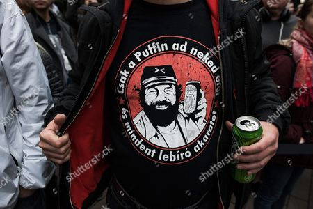 A fan wears a T-shirt depicting late Italian actor Carlo Pedersoli, professionally known as Bud Spencer, during the unveiling ceremony of his bronze statue on Corvin Promenade in Budapest, Hungary, 11 November 2017. Former porfessional swimmer and water polo player Pedersoli, who starred in over twenty films with long-time on-screen partner Terence Hill, died on 27 June 2016, aged 86, in Rome.