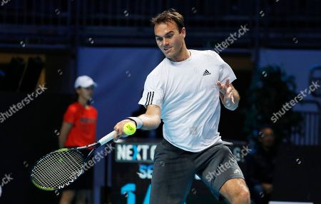 Ross Hutchins, of Britain, returns the ball to Daniil Medvedev, of Russia, during the ATP Next Gen exhibition tennis match, at the Rho fair, near Milan, Italy