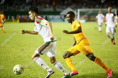 Konan Nclomande Ghislain from Ivory Coast (R) vies for the ball with Hakimi Achraf (L) from Morocco during the FIFA World Cup 2018 play-off matc between the Ivory Coast and Morocco in Abidjan, Ivory Coast, 11 November 2017.