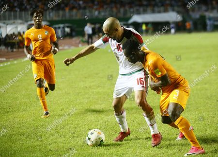 Konan Nclomande Ghislain from Ivory Coast (R) vies for the ball with Amrabat Noureddine (L) from Morocco during the FIFA World Cup 2018 play-off match between the Ivory Coast and Morocco in Abidjan, Ivory Coast, 11 November 2017.