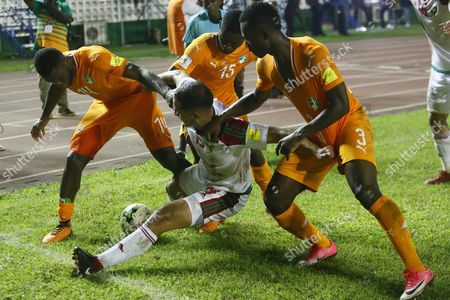 Kessie Franck Yannick (R), Gradel Max Alain (C) and Konan Nclomande Ghislain (R) from Ivory Coast vie for the ball with Amrabat Sofyan (C) from Morocco during the FIFA World Cup 2018 play-off match between the Ivory Coast and Morocco in Abidjan, Ivory Coast, 11 November 2017.