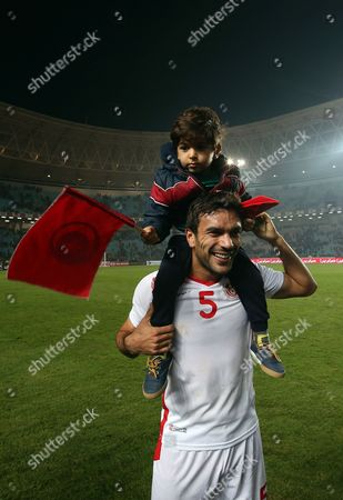 Tunisian player Oussama Haddadi celebrates on the pitch after qualifying for the 2018 World Cup finals after drawing their qualifiers match against Libya at the Rades Olympic Stadium Rades in Tunis, Tunisia, 11 November 2017
