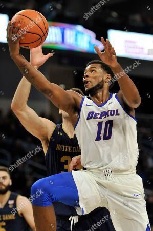 Stock Picture of Tre'Darius McCallum, John Mooney. DePaul's Tre'Darius McCallum (10) goes up for a shot against Notre Dame's John Mooney (33) during the second half of an NCAA college basketball game, in Chicago. Notre Dame won 72-58