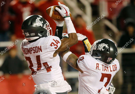 Jalen Thompson, Robert Taylor. Washington State safety Jalen Thompson (34) catches an interception in front of teammate Robert Taylor (2) in the second half during an NCAA college football game against Utah, in Salt Lake City
