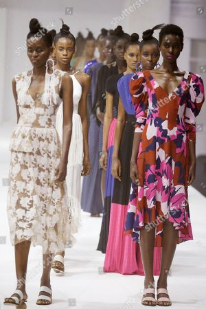 Models display creations by Tracy Reese during the Fashion Week in Lagos, Nigeria