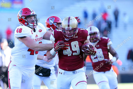 , 2017; Chestnut Hill, MA, USA; Boston College Eagles linebacker Kevin Bletzer (49) recovers a fumble and pursued by NC State Wolfpack tight end Cole Cook (48) during the NCAA football game between NC State Wolfpack and Boston College Eagles at Alumni Stadium. NC State defeated Boston College 17-14