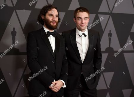 Josh Safdie, Robert Pattinson. Josh Safdie, left, and Robert Pattinson arrive at the 9th annual Governors Awards at the Dolby Ballroom, in Los Angeles