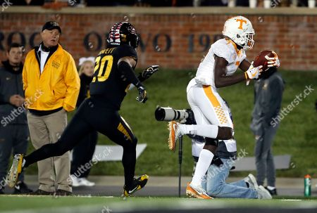 Tennessee wide receiver Brandon Johnson, right, crosses into the end zone past Missouri safety Kaleb Prewett after catching a touchdown pass during the first half of an NCAA college football game, in Columbia, Mo