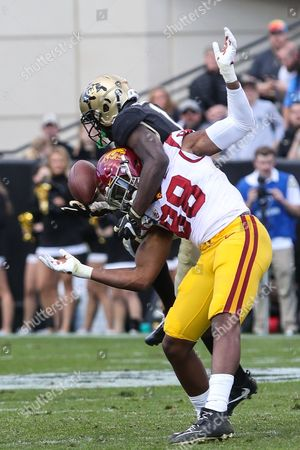 Colorado's Afolab Laguda breaks up a pass intended for USC's Daniel Imatorbhebhe at Folsom Field. The Trojans won 38-24
