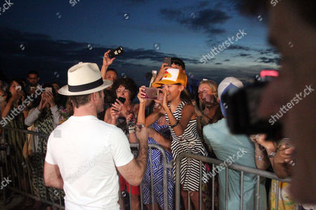 Fans hope for a time with Scott Caan at the Sunset on the Beach event for season 8 of the CBS show Hawaii Five-0 on Waikiki Beach in Honolulu, Hawaii - Michael Sullivan/CSM