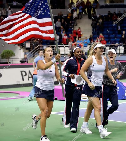 United States' CoCo Vandeweghe, 2nd right, and her teammates Shelby Rogers, left, celebrate Sloane Stephens, 2nd left, and Alison Riske, right, celebrate after defeating Belarus during the Fed Cup final match, in Minsk, Belarus, Sunday, Nov.12, 2017. United States defeated Belarus 3-2 and gained the Fed Cup title