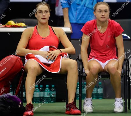 Belarus' Aliaksandra Sasnovich, right, and her teammate Aryna Sabalenka, left, sit on the bench after loosing the Fed Cup final match against United States' CoCo Vandeweghe and Shelby Rogers, in Minsk, Belarus, Sunday, Nov.12, 2017. United States defeated Belarus 3-2 and gained the Fed Cup title