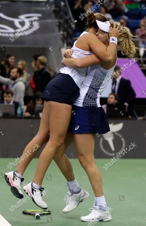 United States' CoCo Vandeweghe, right, and her teammate Shelby Rogers, left, celebrate after defeating Belarus' Aliaksandra Sasnovich and Aryna Sabalenka during the Fed Cup final match between Belarus and USA, in Minsk, Belarus, Sunday, Nov.12, 2017. United States defeated Belarus 3-2 and gained the Fed Cup title