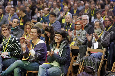 Pro-independence Catalonian party CUP's members, including leaders Mireia Vehi (from left, front), Natalia Sanchez and Anna Gabriel, take part in a party's extraordinary national assembly meeting in Granollers, Barcelona, northeastern Spain, 12 November 2017. The party has to decide the way in which the party will take part in December 21 Catalonian regional election.