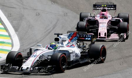 Williams driver Felipe Massa, of Brazil, steers his car ahead of Force India driver Esteban Ocon, of France, on the first lap of the Brazilian Formula One Grand Prix at the Interlagos race track in Sao Paulo, Brazil