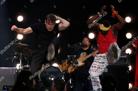 """On, musician Johnny Clegg on stage at a farewell concert in Johannesburg. At 64, his pancreatic cancer in remission, Clegg performed as part of his """"Final Journey"""" tour, delivering the hybrid songs inspired by Zulu and South African township rhythms, as well as pop, folk and country and western, that he developed in defiance of South Africa's apartheid system decades ago"""