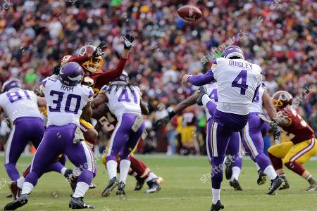 Minnesota Vikings punter Ryan Quigley (4) kicks during an NFL football game against the Washington Redskins, in Landover, Md
