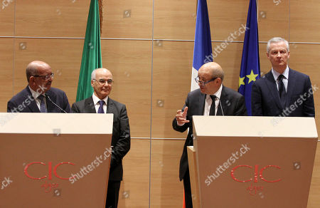Stock Photo of From left, Algeria's Foreign Minister Abdelkader Messahel, Algeria's Minister of Energy and Mines Youcef Yousfi, France's Foreign Minister Jean-Yves Le Drian and France's Finance Minister Bruno Le Maire attend a media conference after a meeting in Algiers, Algeria