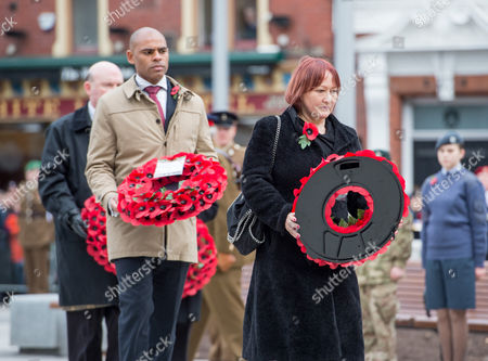 Remembrance Sunday at the Cenotaph in Bristol. Kerry Mccarthy MP takes a wreath to the Cenotaph, followed by the elected Mayor of Bristol Marvin Rees.