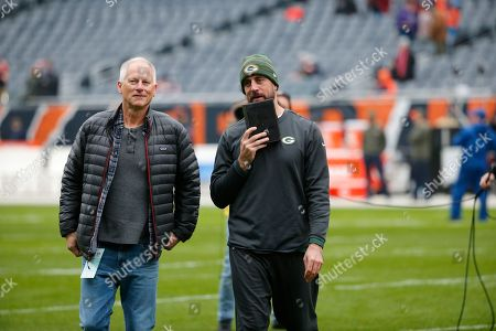 Stock Picture of Aaron Rodgers, Kenny Mayne. Green Bay Packers' Aaron Rodgers, talk to ESPN's Kenny Mayne before an NFL football game against the Chicago Bears, in Chicago