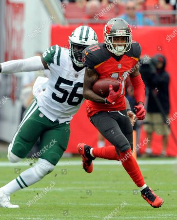 Tampa Bay Buccaneers wide receiver DeSean Jackson (11) outruns New York Jets inside linebacker Demario Davis (56) during the first half of an NFL football game, in Tampa, Fla
