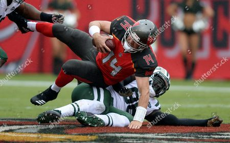 Muhammad Wilkerson, Ryan Fitzpatrick. Tampa Bay Buccaneers quarterback Ryan Fitzpatrick (14) is sacked by New York Jets defensive end Muhammad Wilkerson (96) during the first half of an NFL football game, in Tampa, Fla