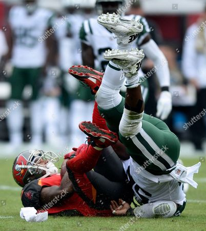 New York Jets inside linebacker Demario Davis (56) takes down Tampa Bay Buccaneers wide receiver DeSean Jackson (11) during the first half of an NFL football game, in Tampa, Fla
