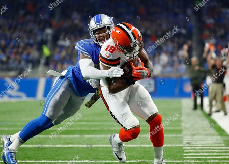 Kenny Britt, Glover Quin. Detroit Lions free safety Glover Quin (27) tries stopping Cleveland Browns wide receiver Kenny Britt (18) from entering the end zone for a touchdown during the first half of an NFL football game, in Detroit