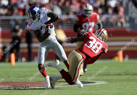 Tavarres King, Adrian Colbert. New York Giants wide receiver Tavarres King (12) runs against San Francisco 49ers defensive back Adrian Colbert (38) during the first half of an NFL football game in Santa Clara, Calif