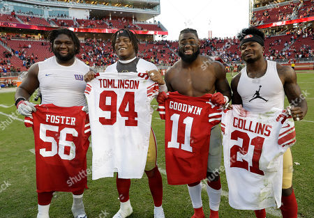 Marquise Goodwin, Reuben Foster, Dalvin Tomlinson, Landon Collins. New York Giants defensive tackle Dalvin Tomlinson, left, poses for photos after swapping jerseys with San Francisco 49ers linebacker Reuben Foster, second from left, as New York Giants strong safety Landon Collins, third from left, swaps jerseys with San Francisco 49ers wide receiver Marquise Goodwin after an NFL football game in Santa Clara, Calif