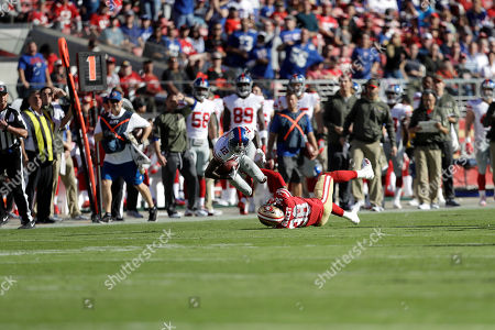 Tavarres King, Adrian Colbert. New York Giants wide receiver Tavarres King (12) is tackled by San Francisco 49ers defensive back Adrian Colbert (38) during the first half of an NFL football game in Santa Clara, Calif