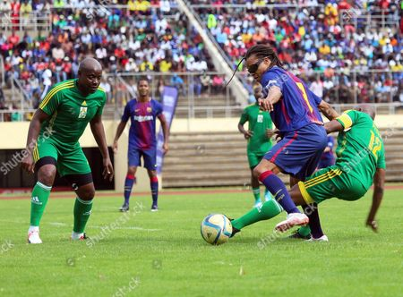 Barcelona FC legend Edgar Davids (C), Zimbabwe legends Peter Ndlovu (R) and Edelbert Dinha (L) during an exhibition soccer match played between Zimbabwe legends and the Barcelona legends at the  National Sports Stadium, Harare, Zimbabwe, 12 November 2017. The match was organised to promote Zimbabwe as a safe tourist destination and also to help to establish links between Zimbabwe and Barcelona soccer.