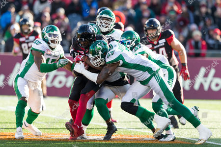 Ottawa Redblacks running back William Powell (29) is surrounded by several Saskatchewan Roughriders defenders during the CFL East Division Semi-Final playoff game between Saskatchewan Roughriders and Ottawa Redblacks at TD Place Stadium in Ottawa, Canada