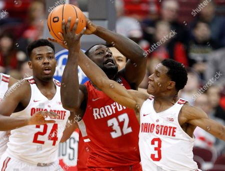 Randy Phillips, Andre Wesson, C.J. Jackson. Radford center Randy Phillips, center, works for a rebound between Ohio State forward Andre Wesson, left, and guard C.J. Jackson during the first half of an NCAA college basketball game in Columbus, Ohio