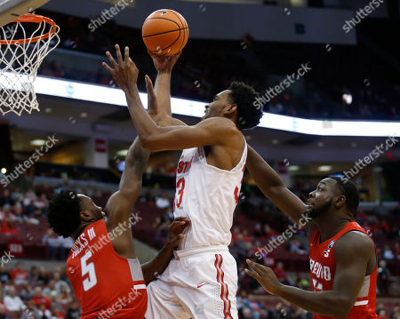 Ohio State forward Keita Bates-Diop goes up to shoot between Radford guard Donald Hicks, left, and center Randy Phillips during the first half of an NCAA college basketball game in Columbus, Ohio