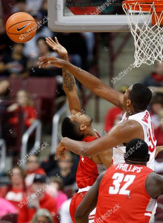 Stock Picture of Kaleb Wesson, Carlik Jones, Randy Phillips. Ohio State forward Kaleb Wesson, top, blocks a shot by Radford guard Carlik Jones, left, in front of Radford center Randy Phillips during the second half of an NCAA college basketball game in Columbus, Ohio, . Wesson was called for a foul on the play. Ohio State won 82-72