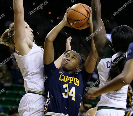 Camille Downs, Lauren Cox, Dekeiya Cohen. Coppin State Eagles guard Camille Downs (34) tries to shoot against Baylor Lady Bears forward Lauren Cox (15), left, and Baylor Lady Bears forward Dekeiya Cohen (1) in the first half of a NCAA college basketball game, in Waco, Tx