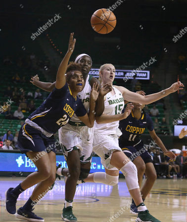 Alexis Taylor, Dekeiya Cohen, Lauren Cox, Candice Beverly. From left to right, Coppin State center Alexis Taylor (24), Baylor forward Dekeiya Cohen, Baylor forward Lauren Cox (15) and Coppin State forward Candice Beverly go after the ball in the second half of an NCAA college basketball game, in Waco, Texas