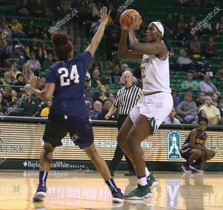 Kalani Brown, Alexis Taylor. Baylor center Kalani Brown (21) looks to pass the ball while defended by Coppin State center Alexis Taylor (24) in the second half of an NCAA college basketball game, in Waco, Texas