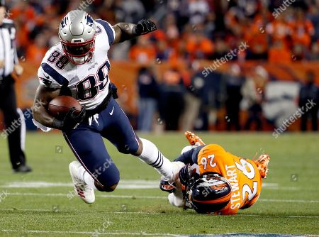 New England Patriots tight end Martellus Bennett (88) runs as Denver Broncos free safety Darian Stewart (26) defends during the first half of an NFL football game, in Denver
